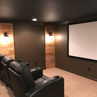 Example of a large urban enclosed carpeted home theater design in Atlanta with black walls and a projector screen