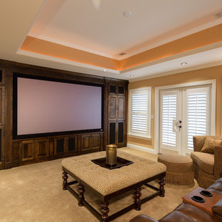 Inspiration for a large traditional open concept home theatre in Atlanta with orange walls, carpet and a projector screen.