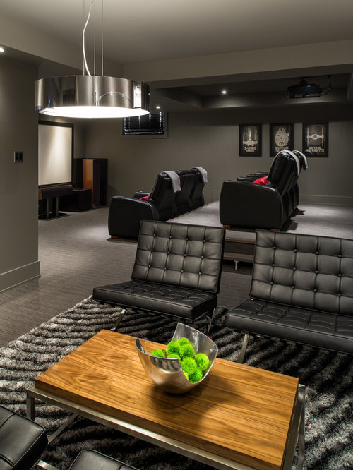 Inspiration for a contemporary home theater remodel in Ottawa with gray  walls