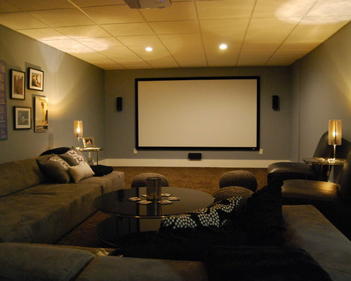Example Of A Minimalist Brown Floor Home Theater Design In Boston