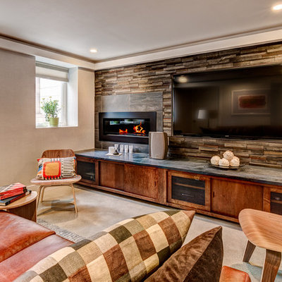Mid-sized trendy enclosed concrete floor home theater photo in Los Angeles with beige walls and a wall-mounted tv