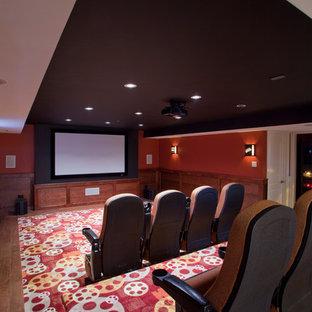 Idee per un home theatre minimal chiuso con pareti rosse e schermo di proiezione