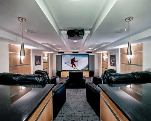 example of a trendy enclosed carpeted home theater design in dc metro with white walls and - Narrow Room Design