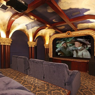 Tuscan enclosed carpeted home theater photo in Miami with a projector screen