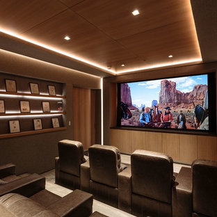 Example of a trendy enclosed carpeted and gray floor home theater design in Los Angeles with gray walls