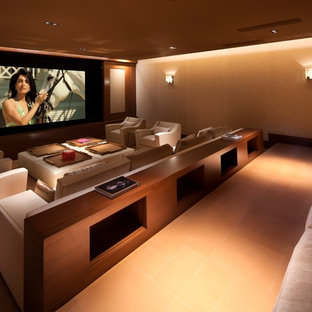 Design ideas for a contemporary home theatre in Orange County with beige walls, a wall-mounted tv and orange floor.
