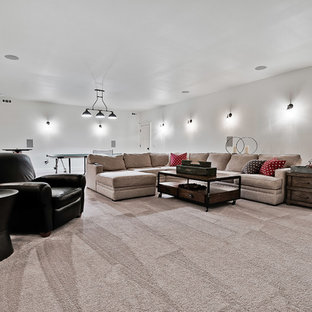 Photo of an expansive arts and crafts enclosed home theatre in Other with white walls, ceramic floors, a wall-mounted tv and beige floor.