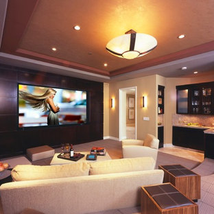 Home theater - contemporary enclosed home theater idea in Los Angeles with a media wall