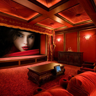 Example of a classic enclosed carpeted and red floor home theater design in Los Angeles with red walls
