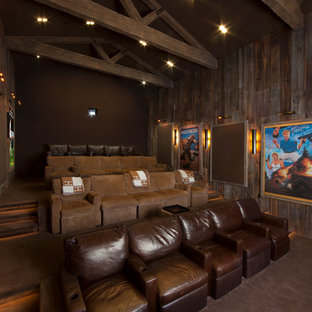 Expansive country open concept home theatre in Los Angeles with brown walls, brown floor, carpet and a projector screen.