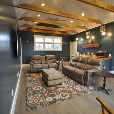 Example of a mid-sized transitional open concept light wood floor and gray floor home theater design in Other with blue walls and a wall-mounted tv