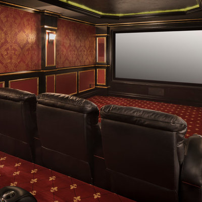 Elegant enclosed carpeted and red floor home theater photo in New York with red walls