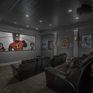 Home theater - mid-sized traditional enclosed carpeted home theater idea in Salt Lake City with gray walls and a projector screen