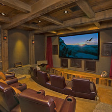 Rustic Home Theater by Locati Architects