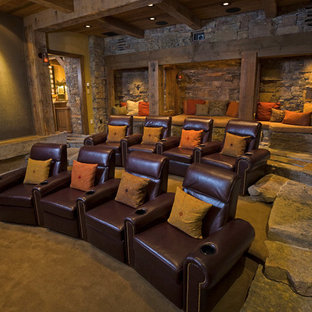 Mountain style enclosed home theater photo in Other with a projector screen