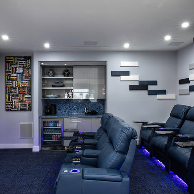 Inspiration for a contemporary enclosed carpeted and black floor home theater remodel in Miami with gray walls and a projector screen