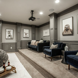 Elegant enclosed carpeted and gray floor home theater photo in Indianapolis with gray walls