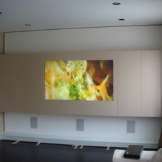 Contemporary Home Theater by Instyle Construction Inc.