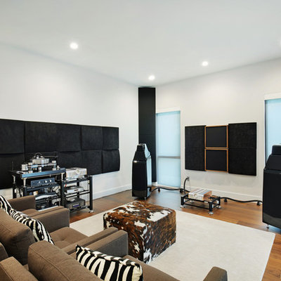 Example of a small minimalist enclosed home theater design in Tampa