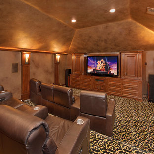 Home theater - mediterranean enclosed carpeted and multicolored floor home theater idea in Houston with a media wall