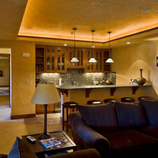 Home theater - rustic open concept carpeted home theater idea in Albuquerque