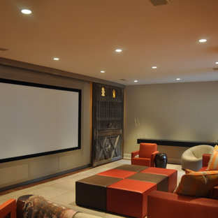 Inspiration for a large contemporary enclosed home theatre in Chicago with beige walls, concrete floors and a projector screen.