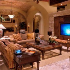 Mediterranean Home Theater by J. Myers & Associates