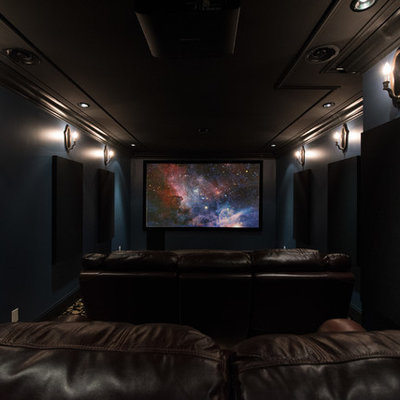 Example of a mid-sized classic enclosed carpeted and black floor home theater design in Vancouver with blue walls and a projector screen