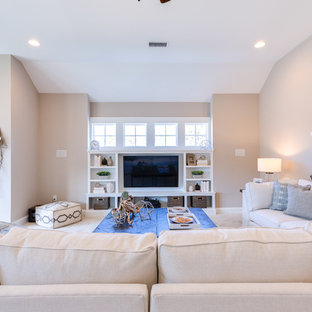 Example of a huge coastal open concept carpeted and white floor home theater design in Other with gray walls and a media wall