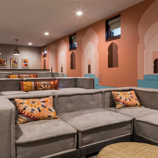 Transitional home theatre in Boston with orange walls, carpet and grey floor.