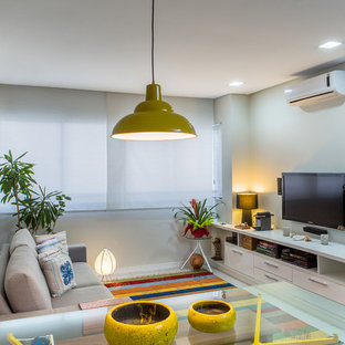 Design ideas for a small contemporary open concept home theatre in Other with beige walls, ceramic floors and a wall-mounted tv.