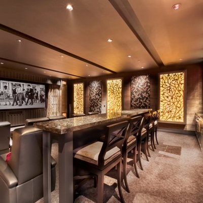 Large trendy enclosed carpeted and brown floor home theater photo in San Diego with brown walls and a projector screen