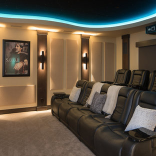 Home theater - rustic enclosed carpeted and beige floor home theater idea in Phoenix with beige walls