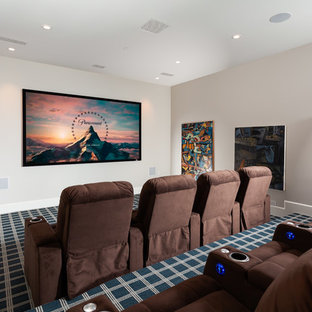 Example of a coastal enclosed carpeted and multicolored floor home theater design in Orange County with gray walls