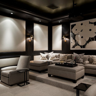 Example of a large classic enclosed gray floor and carpeted home theater design in Miami with black walls and a projector screen
