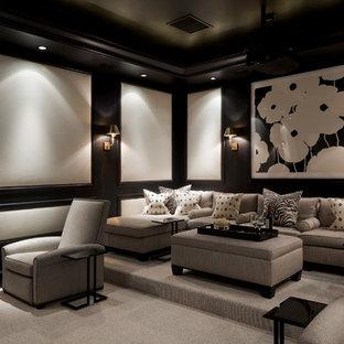 Foto de cine en casa cerrado, tradicional, grande, con suelo gris, paredes negras, moqueta y pantalla de proyección