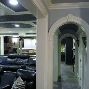 Inspiration for a large traditional enclosed home theatre in Atlanta with grey walls, slate floors, grey floor and a wall-mounted tv.