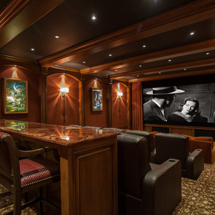 Home theater - large mediterranean enclosed carpeted and multicolored floor home theater idea in Orange County with brown walls and a projector screen