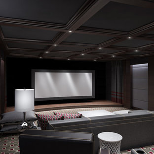 Example of a large trendy enclosed carpeted home theater design in New York with gray walls and a projector screen