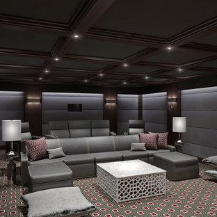 Großes, Abgetrenntes Modernes Heimkino mit grauer Wandfarbe, Teppichboden, Leinwand und buntem Boden in New York
