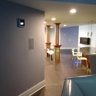 Photo of a mid-sized contemporary home theatre in Chicago with grey walls, ceramic floors, a projector screen and grey floor.