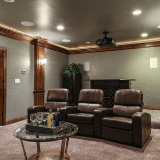 Large mountain style enclosed carpeted and gray floor home theater photo in Dallas with gray walls