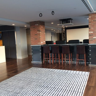 Home theater - large modern open concept dark wood floor home theater idea in Other with white walls and a projector screen