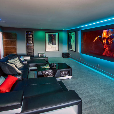 Large trendy enclosed carpeted and gray floor home theater photo in San Francisco with gray walls and a projector screen