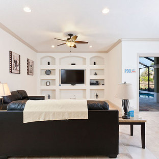 Design ideas for a large beach style open concept home theatre in Orlando with white walls, travertine floors and a built-in media wall.
