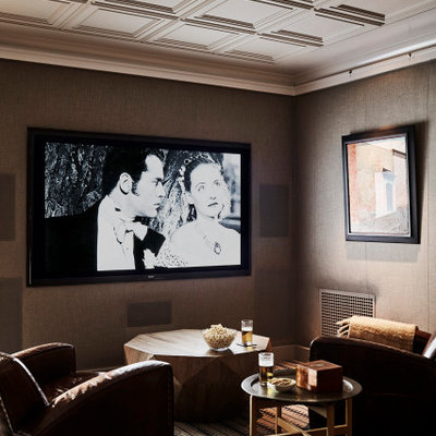 Home theater - small coastal carpeted home theater idea in Los Angeles with a wall-mounted tv