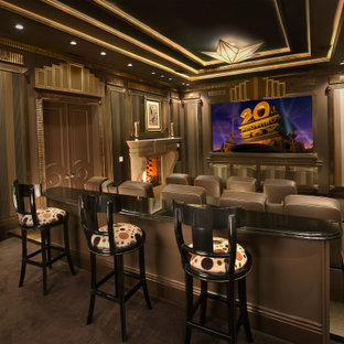 Inspiration for a timeless enclosed carpeted and brown floor home theater remodel in Los Angeles with brown walls and a projector screen