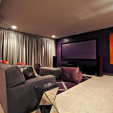 Modern Home Theater by Designwright Studios
