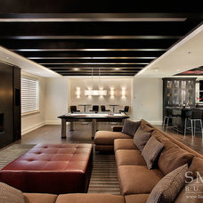 Transitional Home Theater by SMART Construction Group, Ltd.