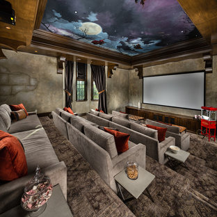 Huge tuscan enclosed carpeted and gray floor home theater photo in Los Angeles with a projector screen and gray walls